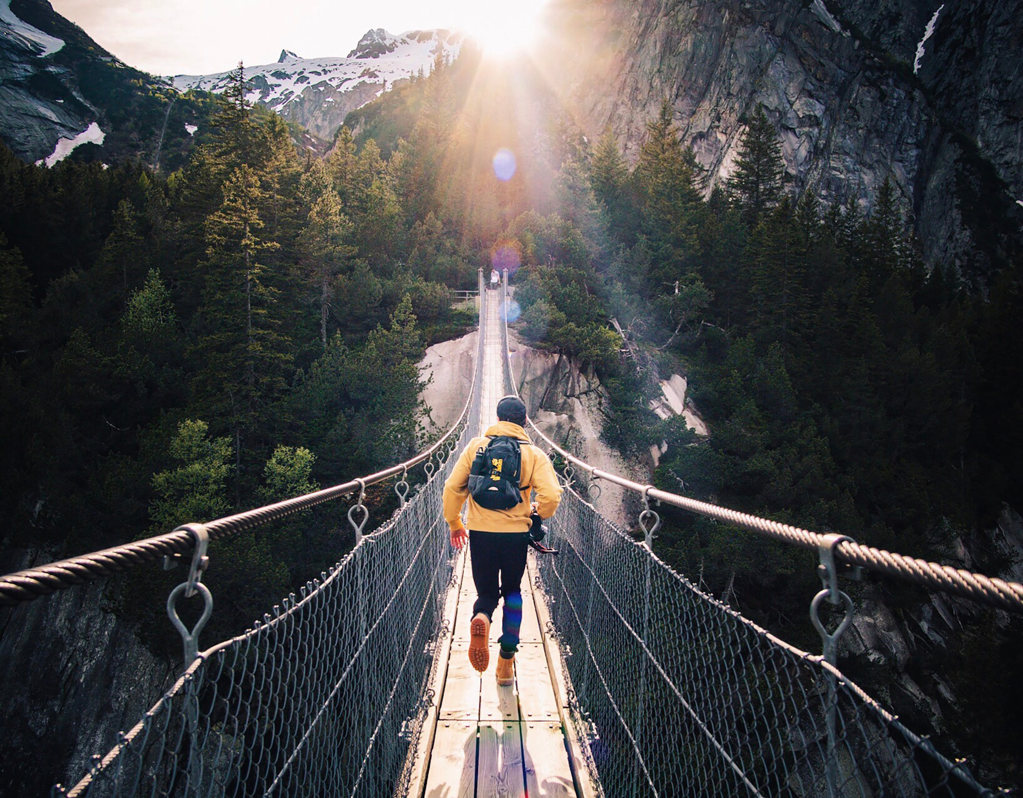 man on mountain bridge